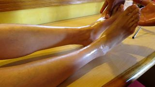 Massaging my feet with oil tickles me